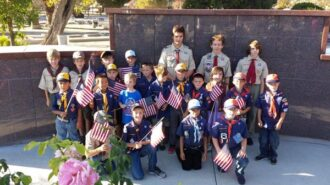 Cub-Scouts-and-Boy-Scouts-from-Templeton-Troop-and-Pack-434-Decorating-Graves-of-Veterens-in-Templeton