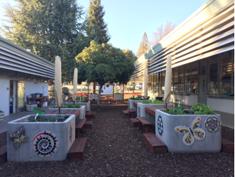 The outdoor learning area with mosaics created by students, using a combination of math and art, and plants planted by students.