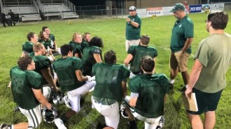 Eagles-Coaches-meet-with-players-600x450