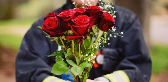 Firefighters selling Valentine's flowers